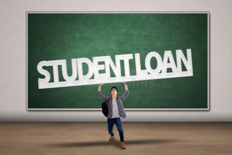 学生举行学生贷款标志 免版税库存图片