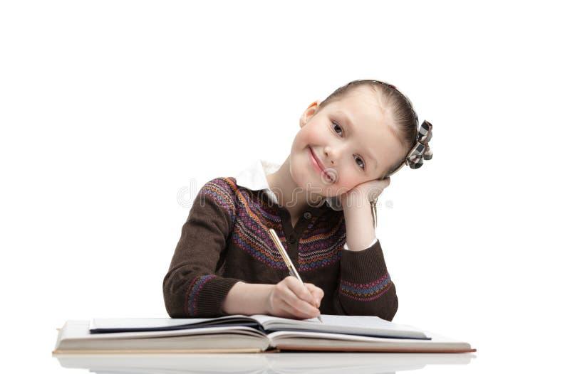 学生乐于执行家庭任务 免版税图库摄影