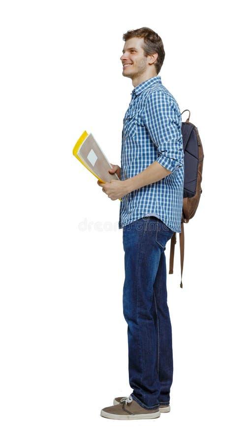 学生侧视图 背着书包和教科书的那个 免版税库存照片