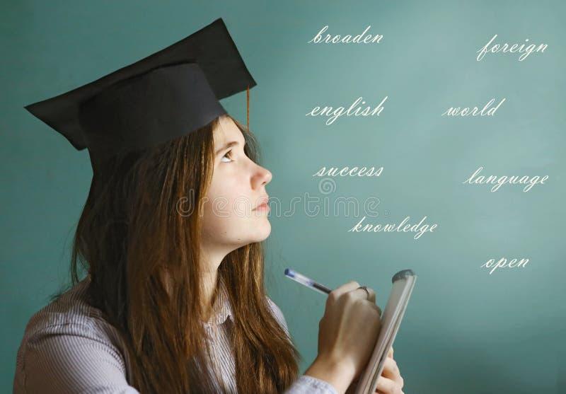 学生语言学家女孩研究英语 免版税图库摄影