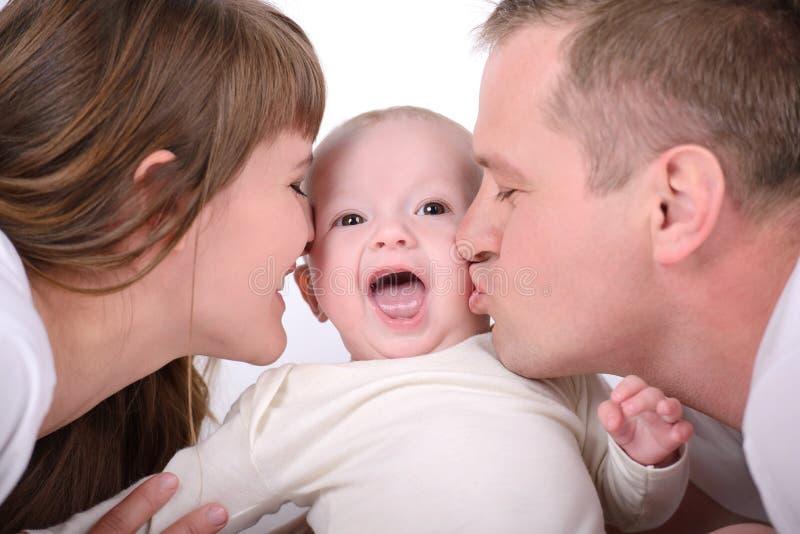 婴孩和父母 免版税图库摄影