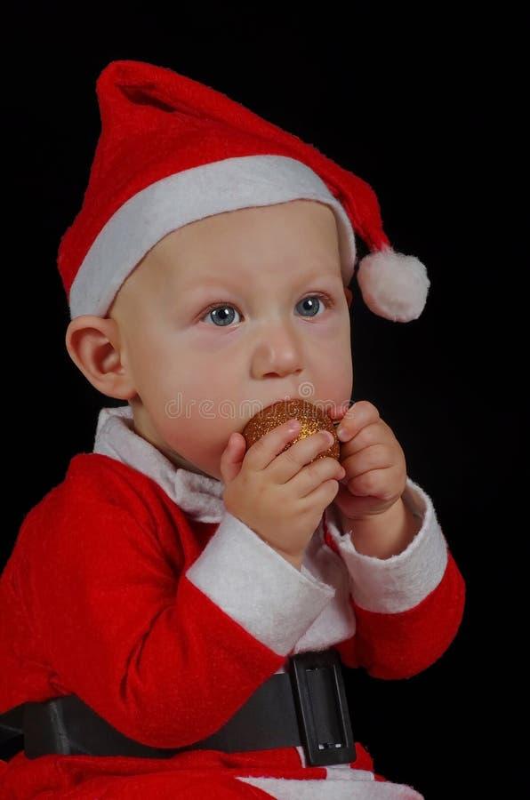 婴孩圣诞节圣诞老人画象 图库摄影