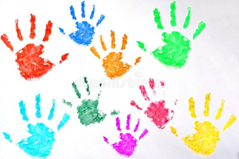 孩子上色了在白色背景的手印刷品 库存照片