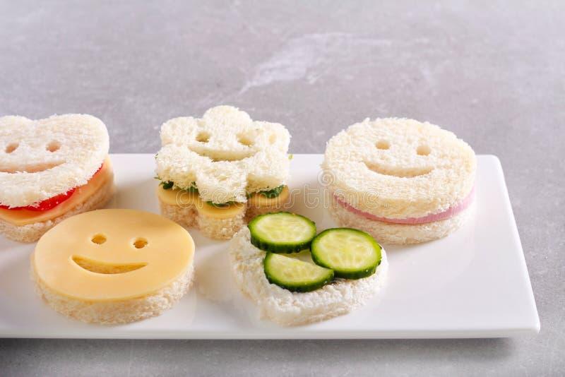 孩子分类了滑稽的三明治 免版税库存照片