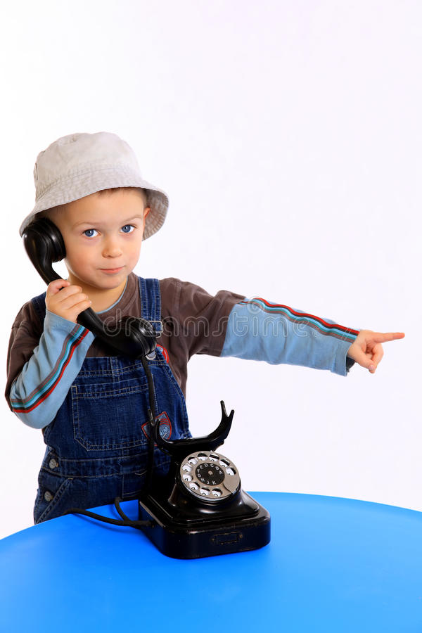 孩子告诉的电话 免版税图库摄影