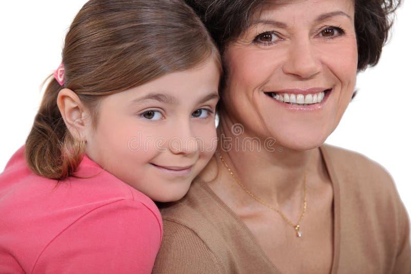 孩子和祖母 免版税库存照片