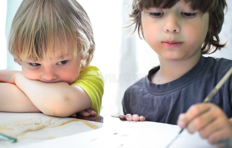 孩子在家画 免版税库存图片