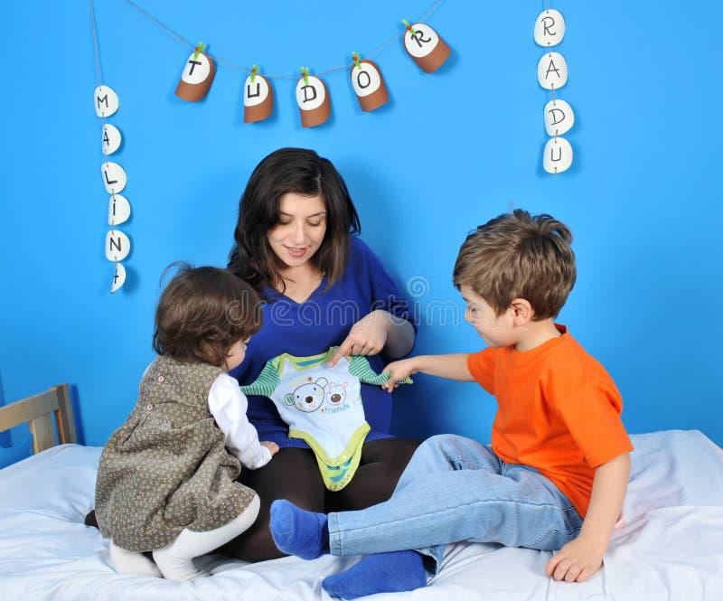 孩子小孕妇 免版税图库摄影