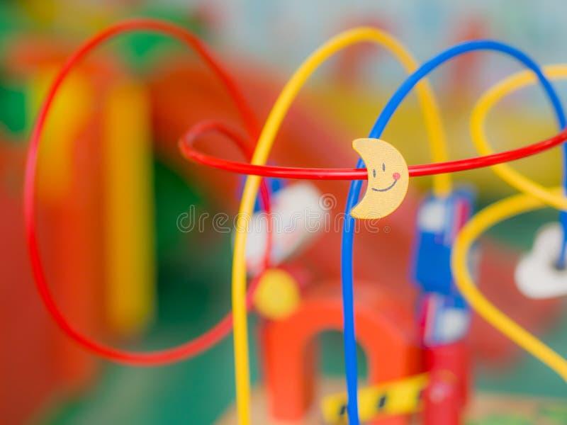孩子戏弄,帮助开发想法的玩具 免版税库存图片