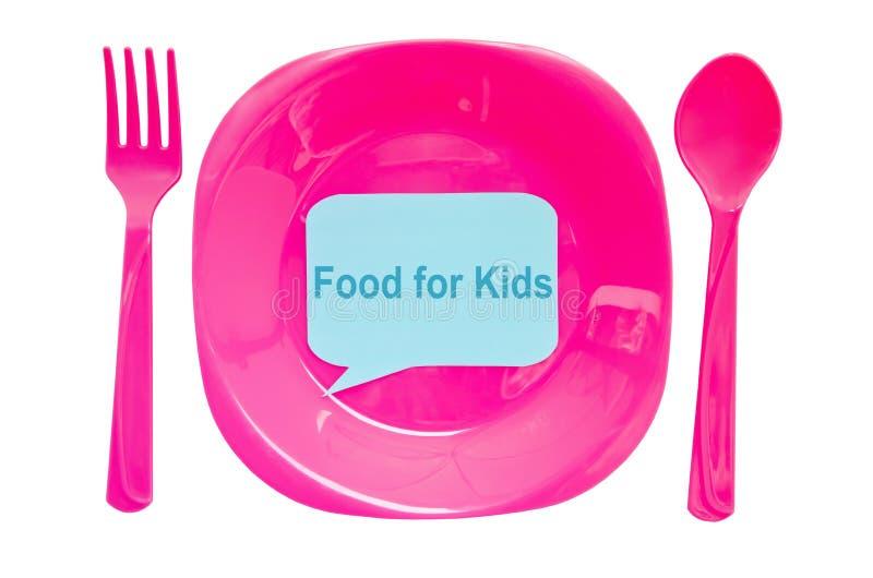 孩子标签的在白色ba隔绝的食物在空的盘和匙子 库存图片