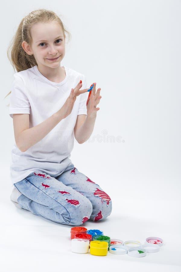 孩子概念 滑稽的女孩画象用明亮地被绘的手 图库摄影