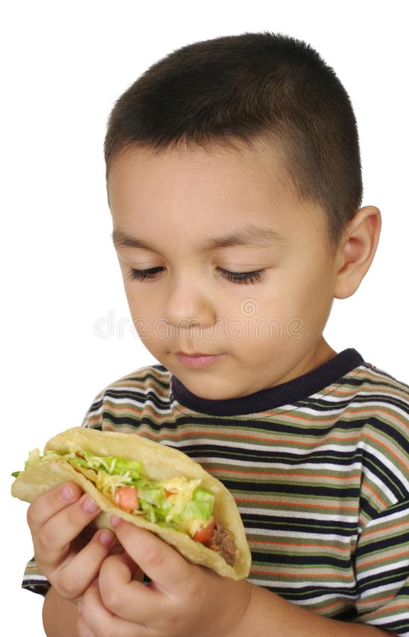孩子炸玉米饼三年 免版税库存图片