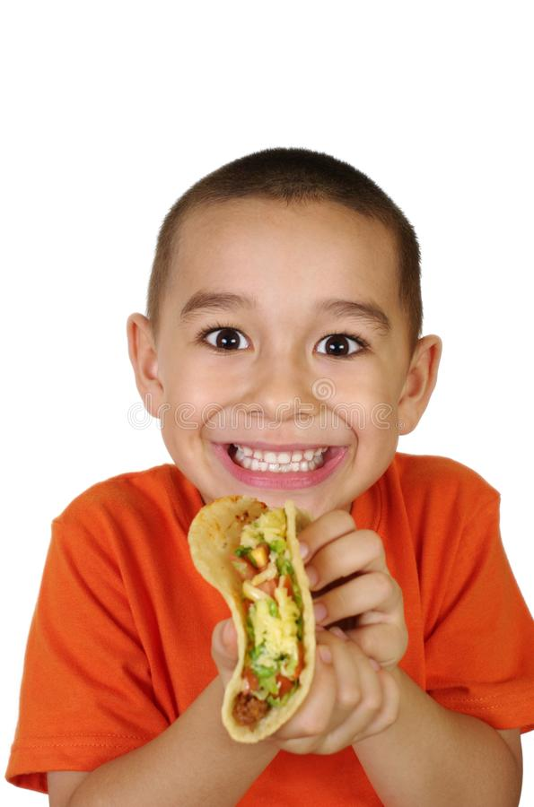 孩子炸玉米饼 免版税库存图片
