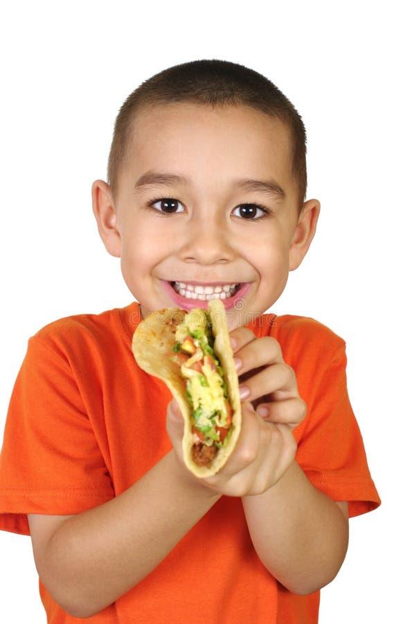 孩子炸玉米饼 库存图片