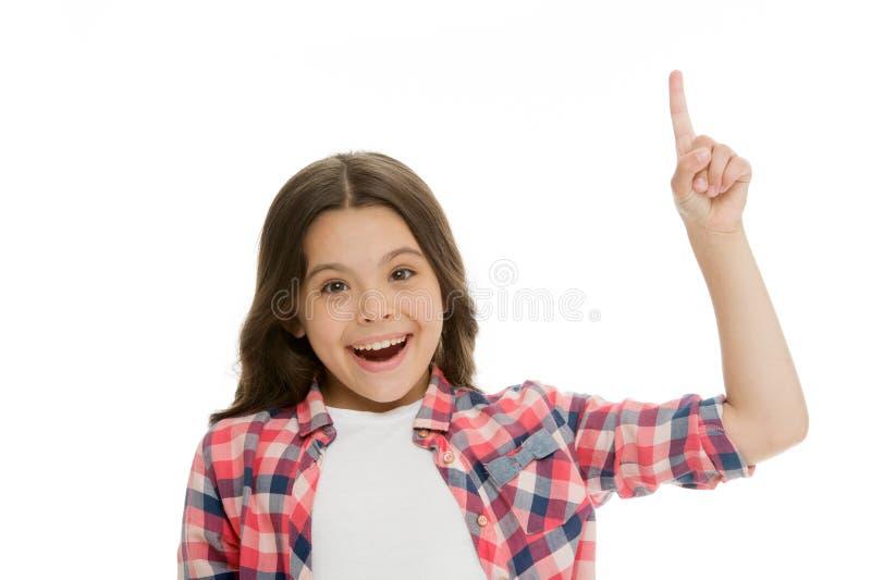 孩子点手指被隔绝的白色 向上指向儿童逗人喜爱的面孔深色的头发 女孩偶然神色推荐检查 库存照片