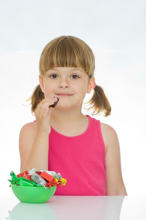 孩子爱甜点 库存图片