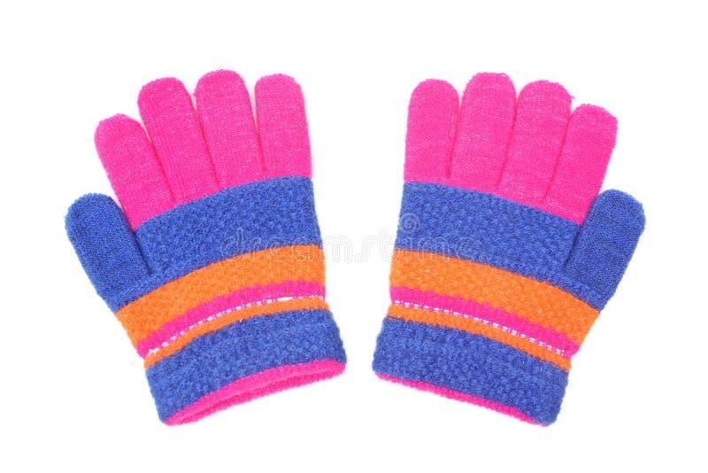 孩子的五颜六色的手套 免版税库存图片