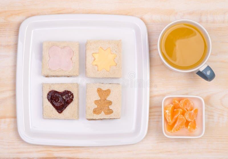 孩子的逗人喜爱的三明治 免版税图库摄影