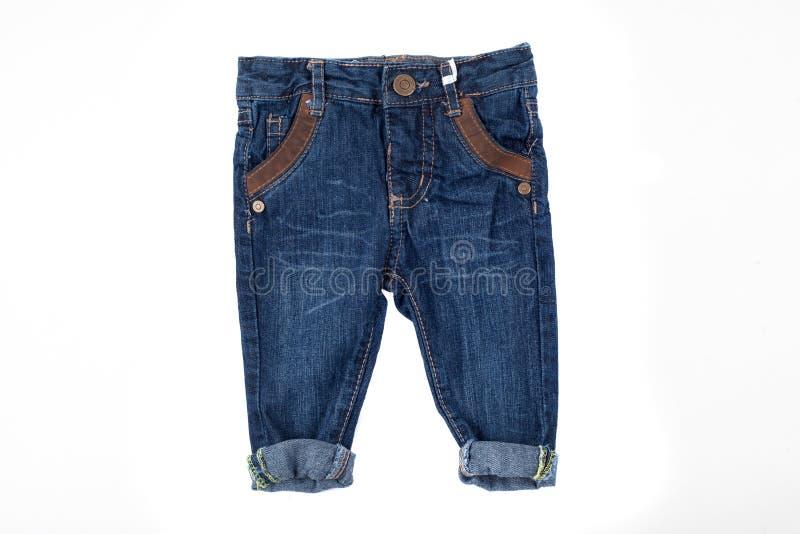 孩子的逗人喜爱的牛仔裤,被隔绝 免版税库存照片