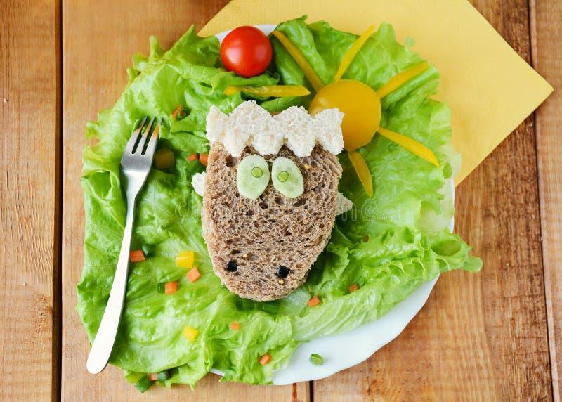 孩子的绵羊形状的滑稽的三明治 库存图片