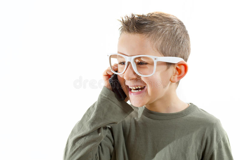 孩子谈话在手机 免版税库存照片