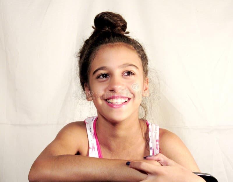 孩子青少年的制造的面孔微笑 免版税库存图片