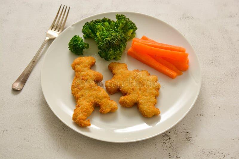 孩子食物 与菜的矿块 恐龙塑造了鸡、鱼或者火鸡矿块,立即可食 图库摄影