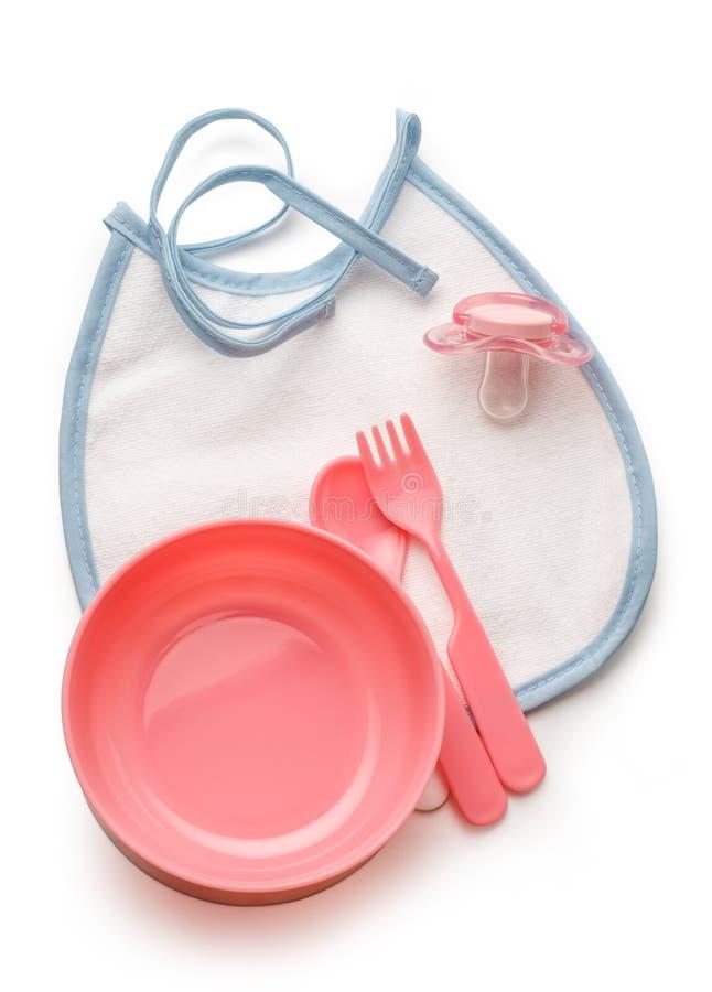 婴孩碗、匙子和叉子与钝汉 免版税库存照片
