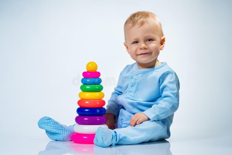 婴孩礼服八女孩少许月粉红色thr 库存照片