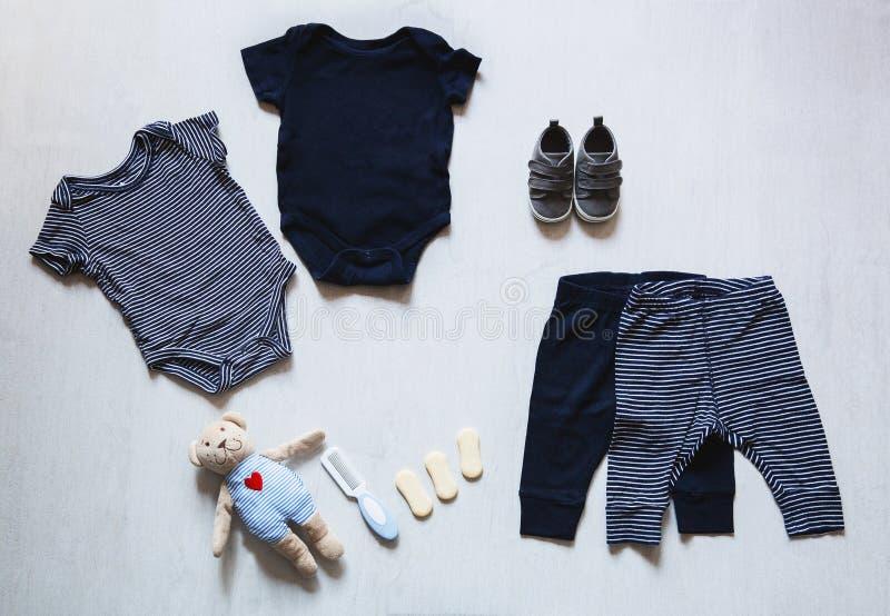 婴孩衣裳,儿童时尚的概念 库存图片