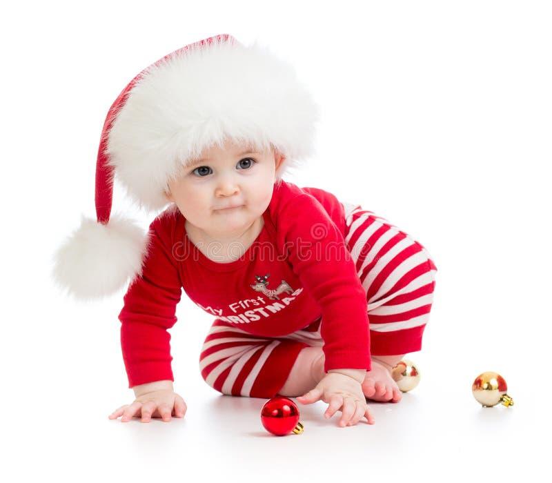 婴孩被隔绝的weared圣诞老人衣裳 库存照片