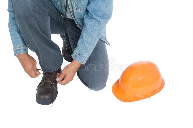 安全靴变褐帽子和桔子 库存照片