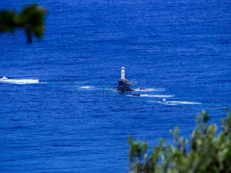 安德罗斯海岛白色灯塔,在基克拉泽斯,希腊 库存照片