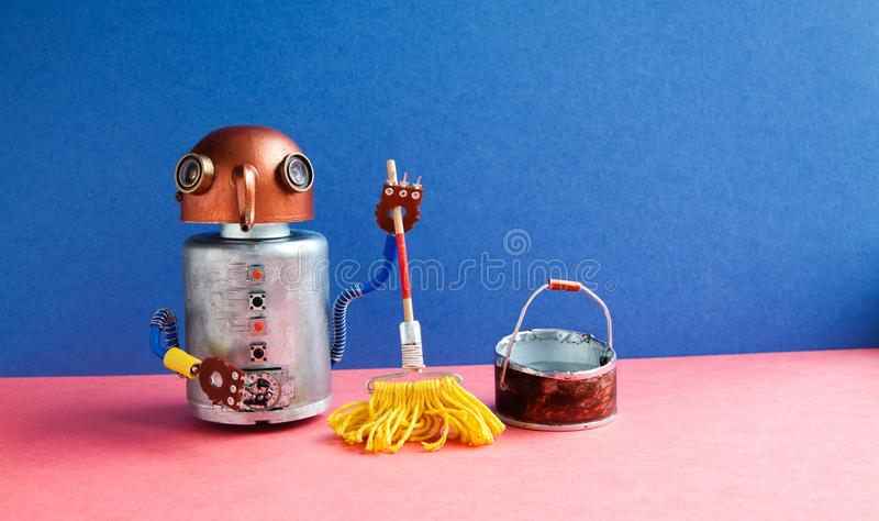 安置机器人擦净剂黄色拖把,桶水 友好的技工玩具字符擦的洁净室 蓝色墙壁桃红色 图库摄影