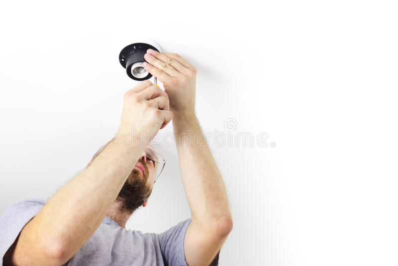 安装光的上升限度电工 免版税库存图片