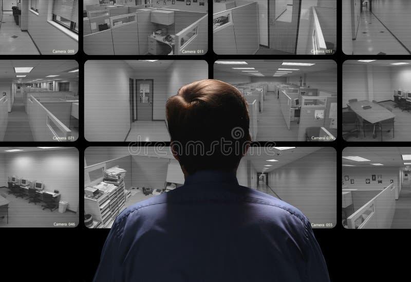 治安警卫举办的监视通过观看几secur 免版税库存图片
