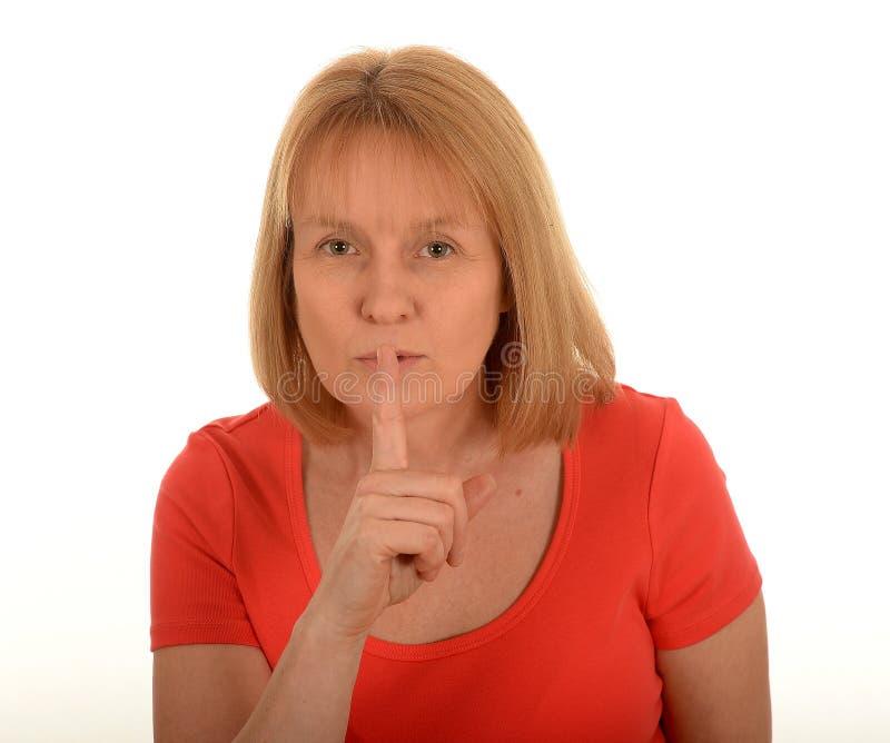 安静地打手势的妇女 免版税图库摄影