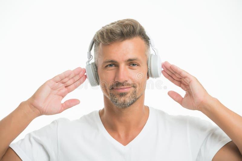 完善的声音 细听音乐刺激 喜爱的体育的轨道名单无线耳机 现代耳机 图库摄影