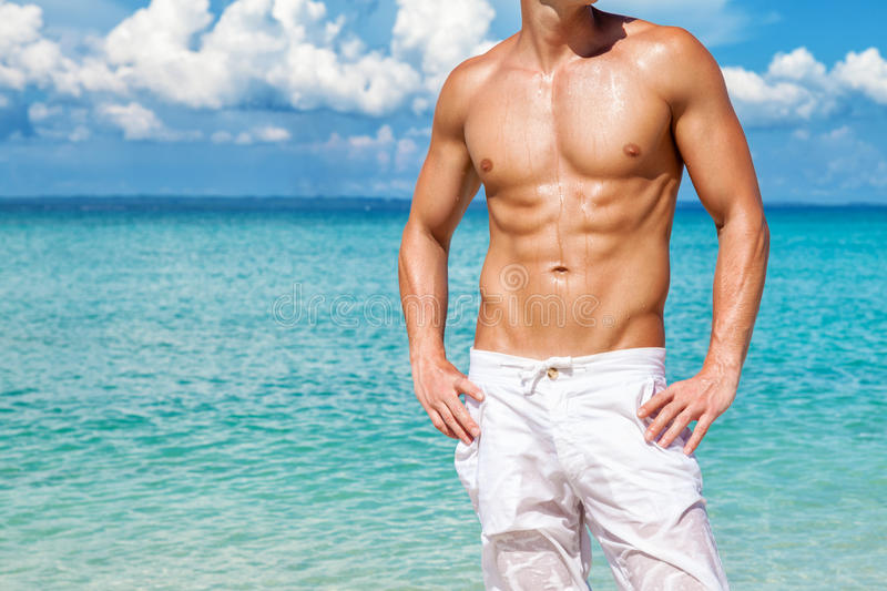 完善的海滩身体为夏天 库存照片