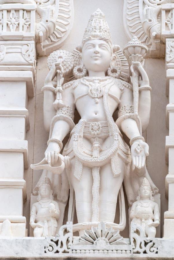 宗教雕象在印度寺庙小面包Shri Swaminarayan Mandir外面在休斯敦,TX 免版税库存图片