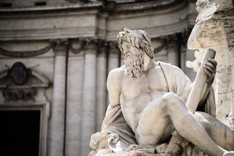 宙斯雕象在喷泉,纳沃纳广场,罗马,意大利的 库存照片