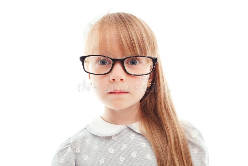 宜人的小女孩佩带的玻璃 库存图片