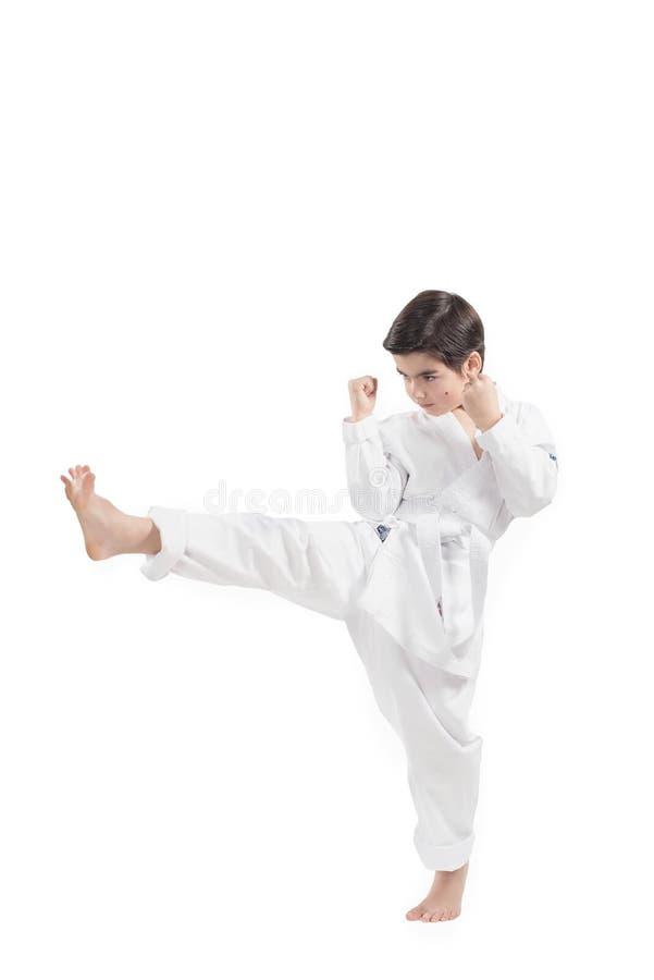 实践武术和jiu jitsu的和服的男孩 库存图片