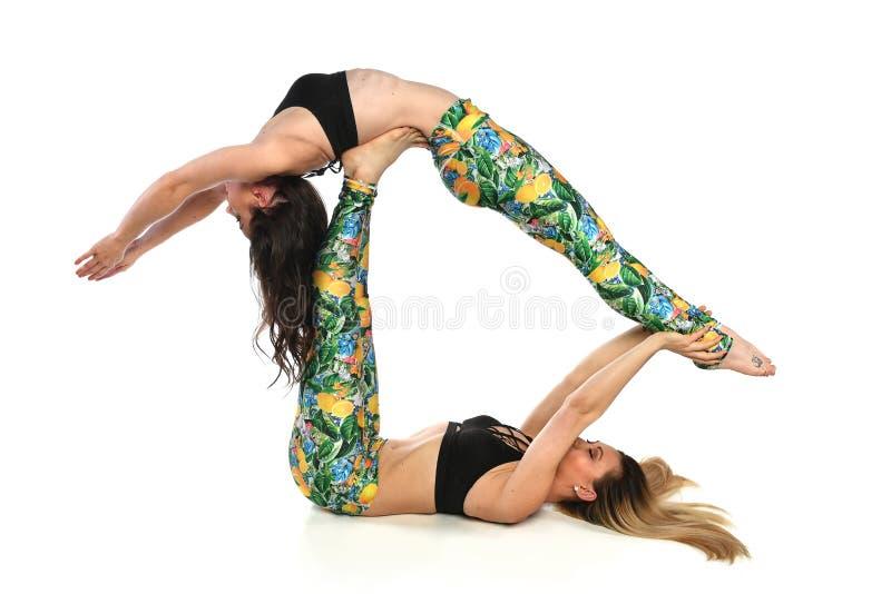 实践的妇女平衡瑜伽 库存图片