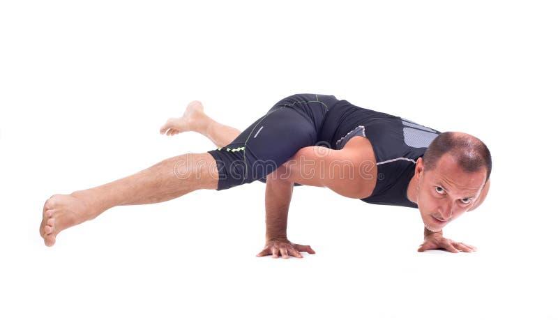 实践的瑜伽锻炼:挑战姿势- Koundiyanasana 图库摄影