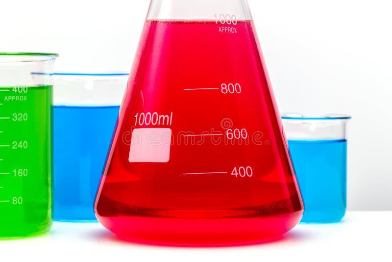 实验室玻璃集合充满紧密五颜六色的物质  库存图片