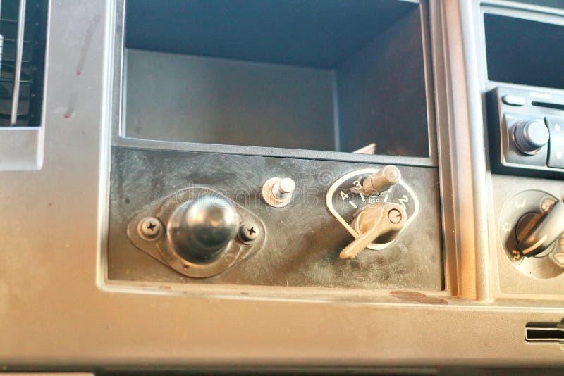 客舱的特写镜头照片与一定数量的开关的,被修改在军车里面,葡萄酒绿色背景 库存照片