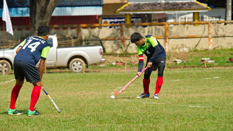 室外曲棍球 行动的曲棍球运动员在泰国全国运动会期间 库存照片