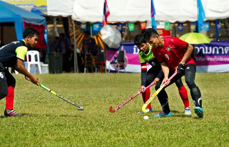 室外曲棍球 行动的曲棍球运动员在泰国全国运动会期间 库存图片