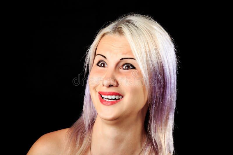 害怕的女性面孔 库存图片